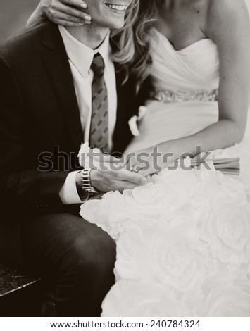 young caucasian groom and bride. holding wedding bouquet - stock photo