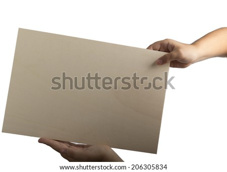 Young caucasian hands holding a light color plywood square blank signboard isolated on white background. There are no elements to distract viewer from reading any  message written on the sign - stock photo