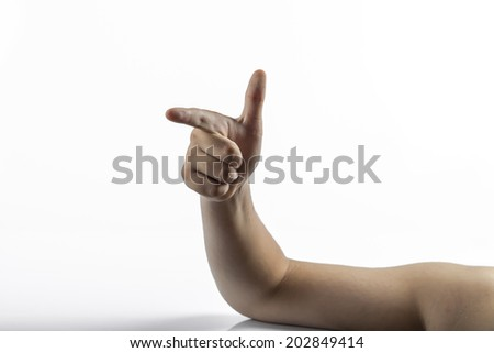 Young caucasian hands pointing fingers as a gun from right to left isolated on a white background. Gesture is number two sign too.  Elbow is supported by a white table with little shadow of the arm.  - stock photo