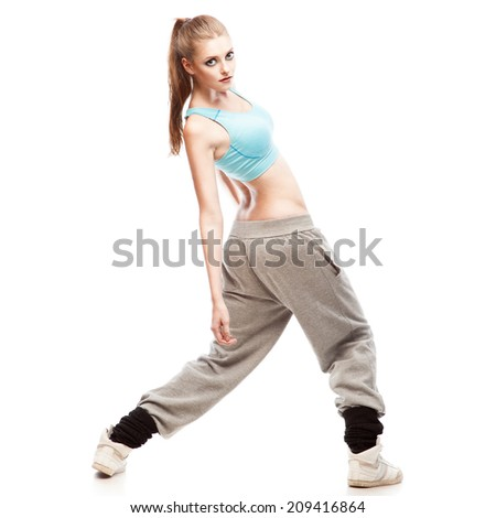 young caucasian hip-hop dancer woman showing some moves