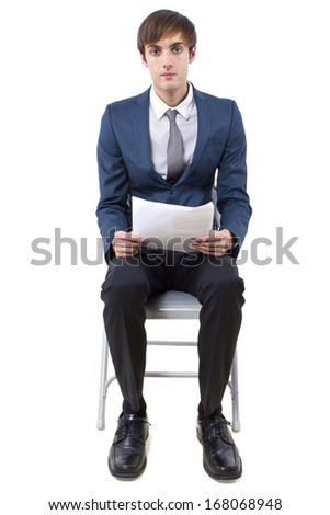 young caucasian male waiting for a job interview