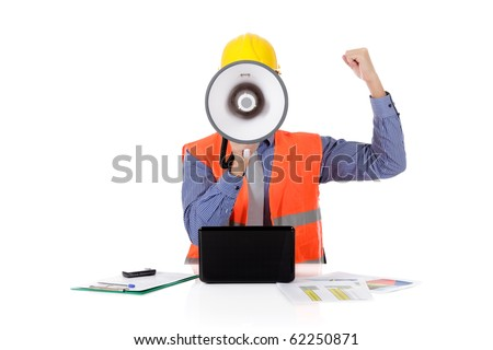 Young  caucasian man architect with safety helmet in the office and working with laptop, megaphone in front face, clench one's fist. Studio shot. White background. - stock photo