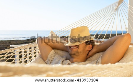 young caucasian man in a hammock - stock photo