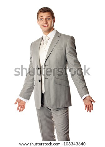 Young Caucasian man in a suit looking amazed - stock photo