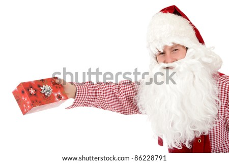 Young caucasian man in Santa Claus clothes giving gift box. Studio shot. White background. - stock photo