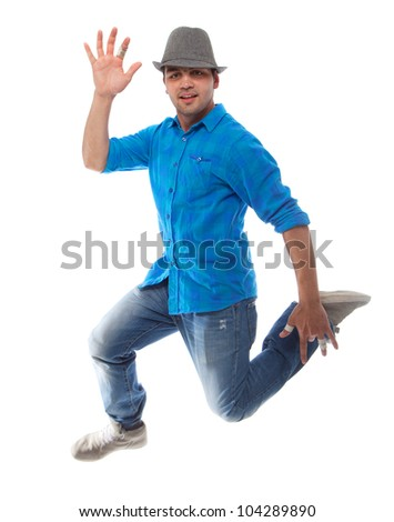 Young caucasian man jumping over isolated white background. - stock photo