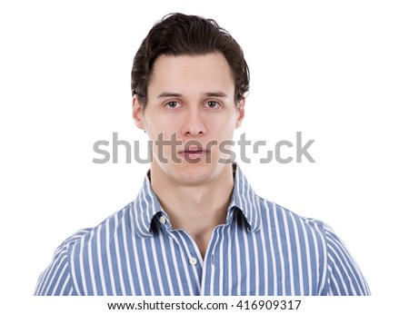 young caucasian man wearing blue shirt and black pants on white background