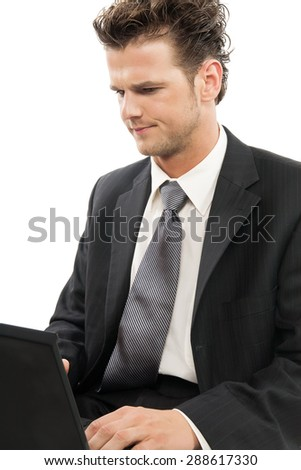 Young Caucasian man working on laptop looking concerned indoors over white background. - stock photo