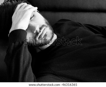 Young caucasian model having a bad day - stock photo