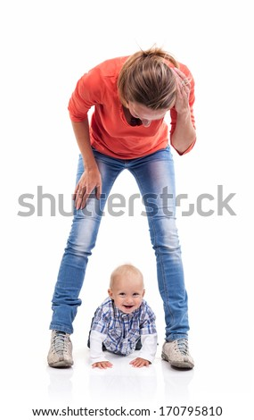 Young Caucasian mother and baby boy playing over white - stock photo
