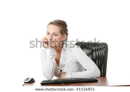 Young caucasian office worker woman behind the desk. Isolated on white background