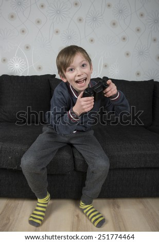 Young caucasian preteen playing a video game - stock photo