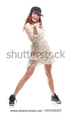 young caucasian red-haired female dancer showing move over white background