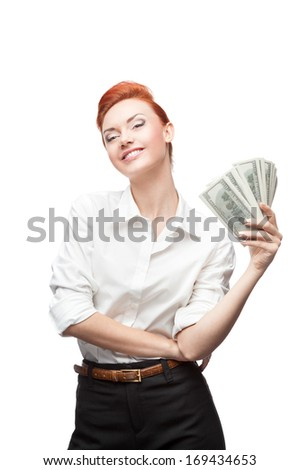 young caucasian red-haired happy smiling business woman holding money isolated on white