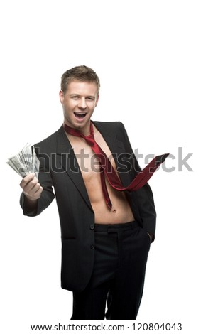young caucasian smiling man in black suit and red tie dressed over naked body which holding money and winking