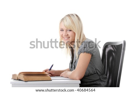 Young caucasian student woman sitting at the desk with book