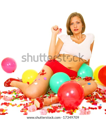 young caucasian surrounded by bunch of candies and balloons