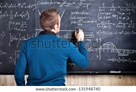 young caucasian teacher portrait with blackboard background