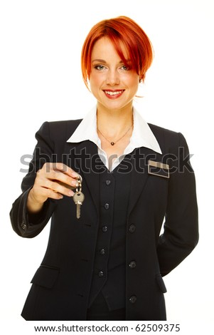 young caucasian woman as hotel worker offering key