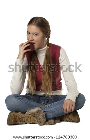 Young caucasian woman biting a red apple - stock photo