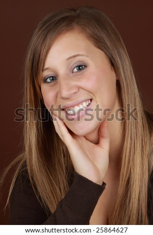 young caucasian woman, brown background