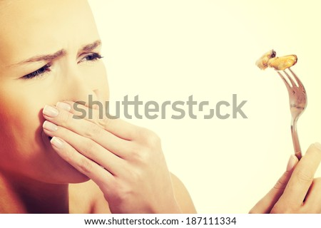 Young caucasian woman eating seafood with disguise.  - stock photo