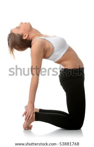 Young caucasian woman exercising yoga - stock photo