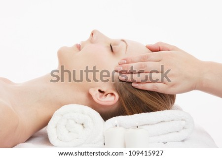Young Caucasian woman facial massage