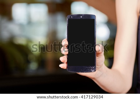 Young caucasian woman holding a mobile phone