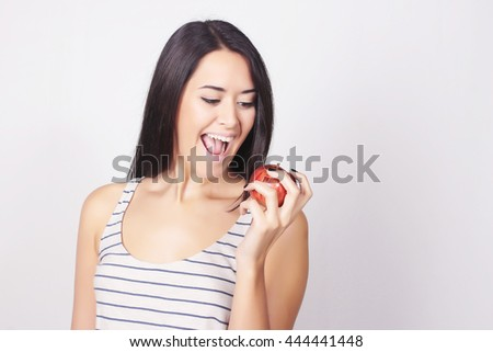 Young caucasian woman holding apple. Fitness and diet concept. Healthy lifestyle. - stock photo