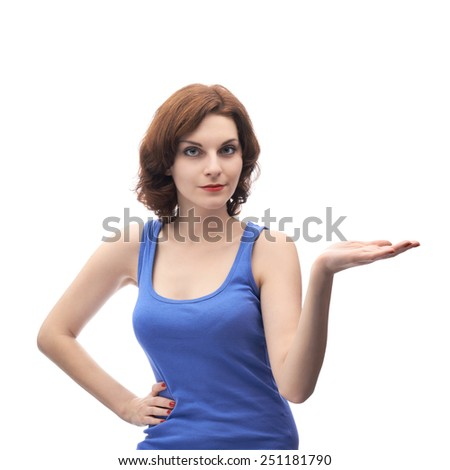 Young caucasian woman in a blue tank top holding her opened palm next to her as if holding or showing something, copyspace composition isolated over the white background - stock photo