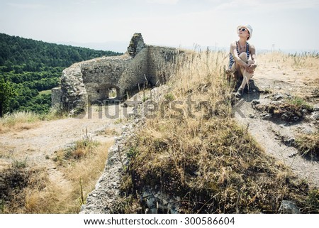 Young caucasian woman in a sailor outfit posing in Cachtice castle, Slovak republic. Travel destination. - stock photo
