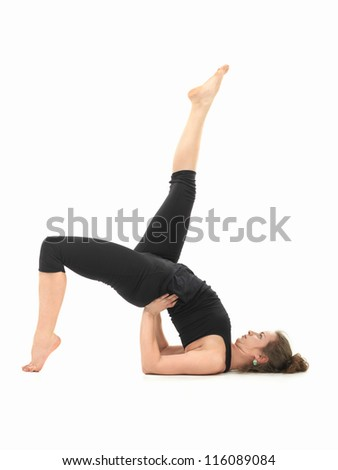 young Caucasian woman in balancing yoga pose - stock photo
