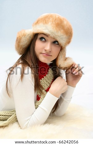 Young caucasian woman in fluffy hat