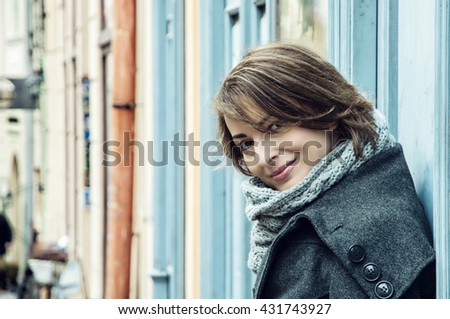 Young caucasian woman in love is leaning on the retro wall in Banska Stiavnica. Beauty and fashion. Female portrait.