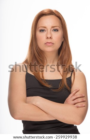 Young Caucasian woman in studio serious face portrait - stock photo