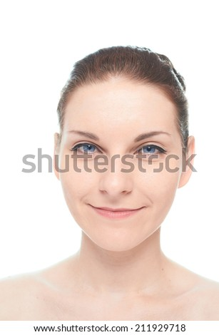 Young caucasian woman portrait with a sly and tricky facial expression, isolated over the white background, natural make up and postprocessing