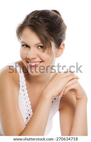 Young Caucasian woman posing on white background.