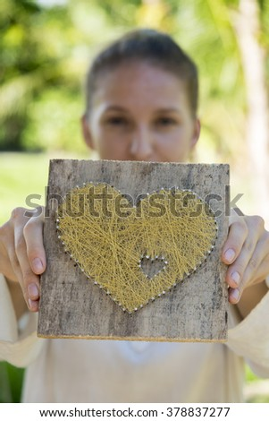 Young caucasian woman  showes symbolic heart
