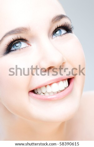 young caucasian woman smiling happily, beauty shot