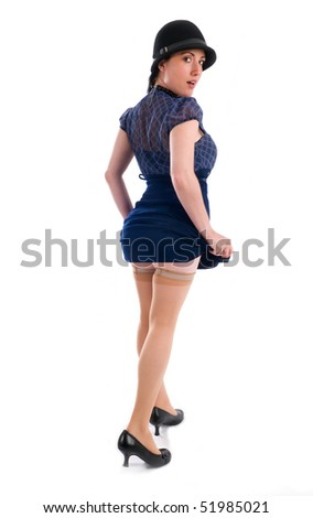 Young caucasian woman standing posing showing legs.
