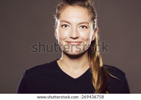 Young Caucasian woman straight on looking at viewer while smiling - stock photo
