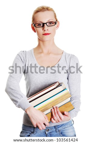 Young caucasian woman (student) with books isolated on white background - stock photo