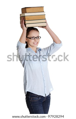 Young caucasian woman (student) with books on her head - stock photo