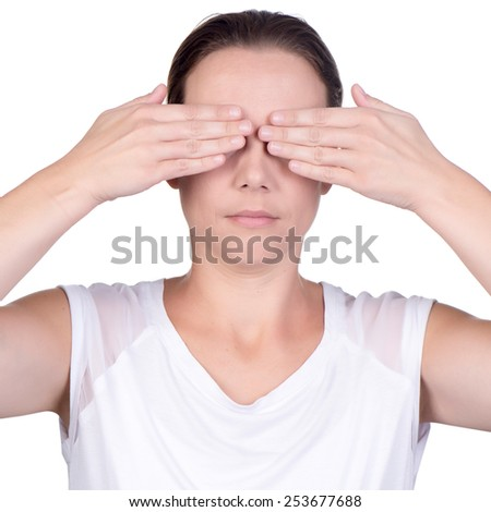 Young caucasian woman using both hands to cover her eyes  - stock photo