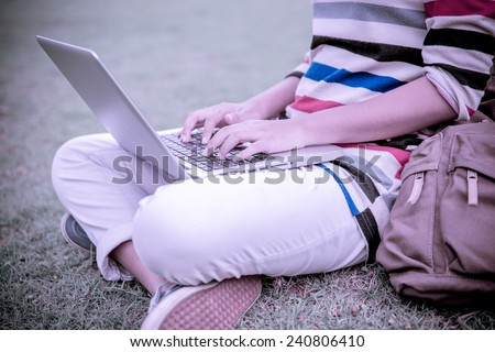Young Caucasian woman using Laptop on nature - stock photo