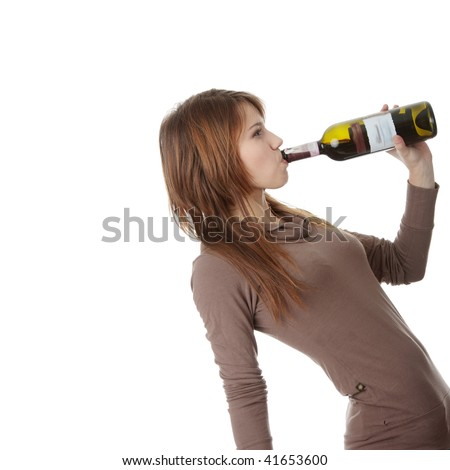 Young caucasian woman with bottle of red wine, isolated on white - stock photo