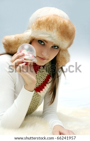 Young caucasian woman with christmas toy