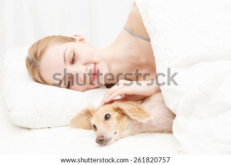 Young caucasian woman with dog
