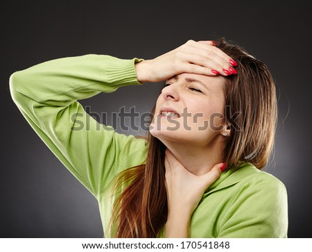 Young caucasian woman with flu and a severe throat pain - stock photo
